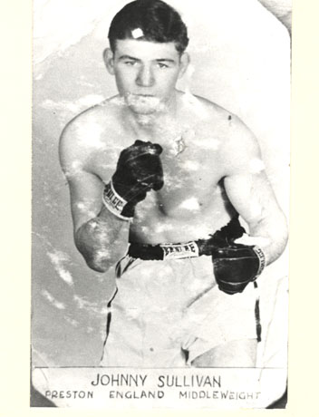 Photograph of a young man stripped to the waist wearing boxing shorts and boxing gloves, facing the camera with his fists raised; under the picture are the following words: Johnny Sullivan Preston England Middleweight