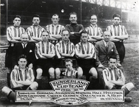 Photograph of twelve men in football strip, posed with two other men, in a football stadium; they have been identified as members of the Sunderland Cup Team 1936-37; they have been identified as follows: Back Row, Left to Right: Thomson; Gorman; Johnston; Mapson; Hall; Hastings; Middle Row, Left to Right: John Cochrane Secretary Manager; Carter; Gurney; Gallacher; A. Reid, Trainer; Front Row, Left to Right: Duns; Burbanks; Inset: McNab